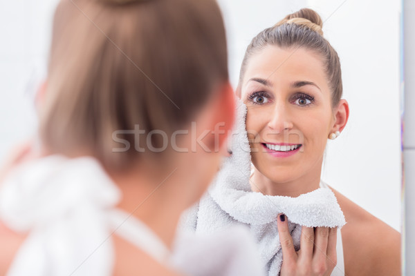 Woman in bathroom towelling face  Stock photo © Kzenon