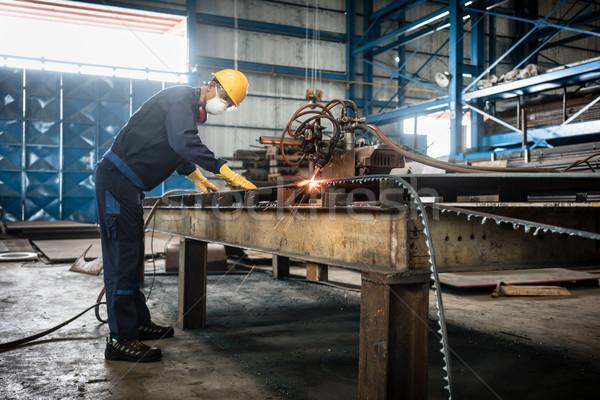 Asian worker using CNC plasma cutter Stock photo © Kzenon