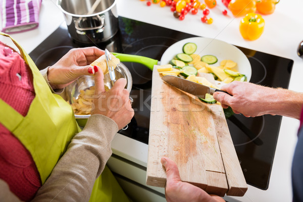 Young couple cooking together in kitchen Stock photo © Kzenon