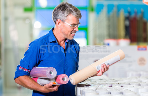 Dad choosing wallpapers for girls room in hardware store Stock photo © Kzenon