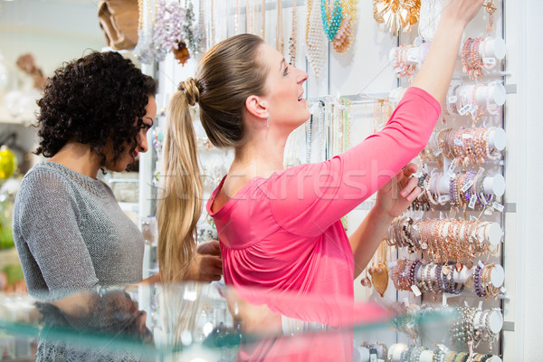 Two friends choosing jewellery in fashion store Stock photo © Kzenon