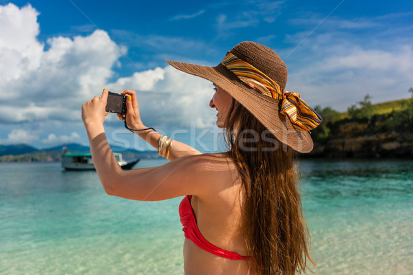 Young woman taking pictures in a sunny day during summer vacation Stock photo © Kzenon