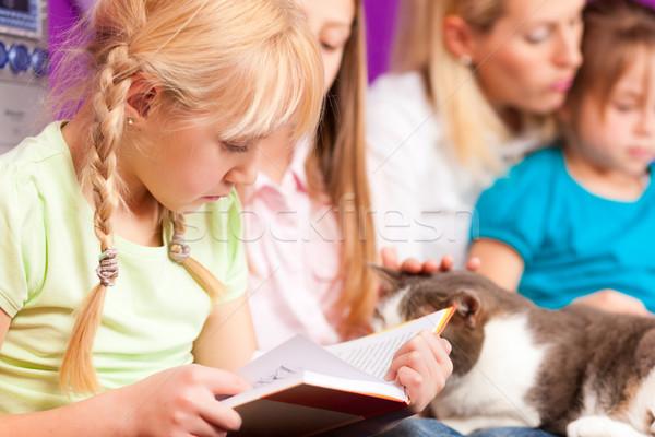 Anya olvas könyv boldog család gyerekek ül Stock fotó © Kzenon