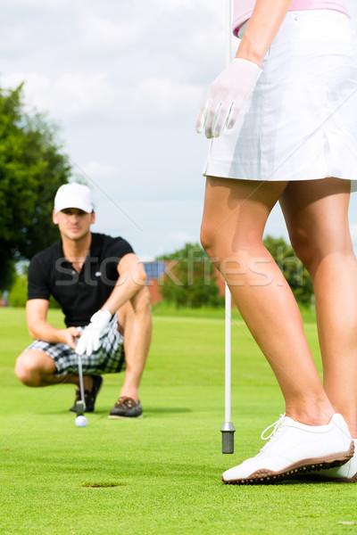 молодые пару играет гольф гольф зеленый Сток-фото © Kzenon