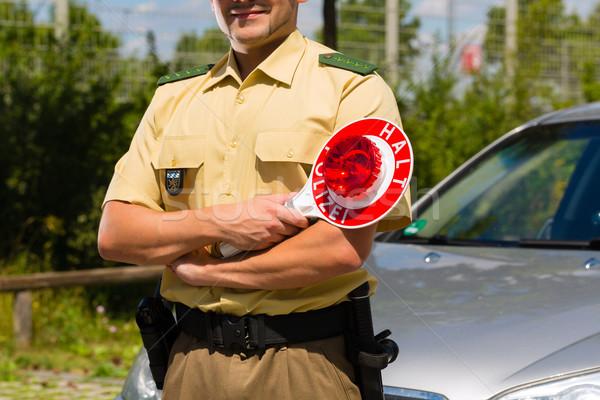 Police - policeman or cop stop car Stock photo © Kzenon
