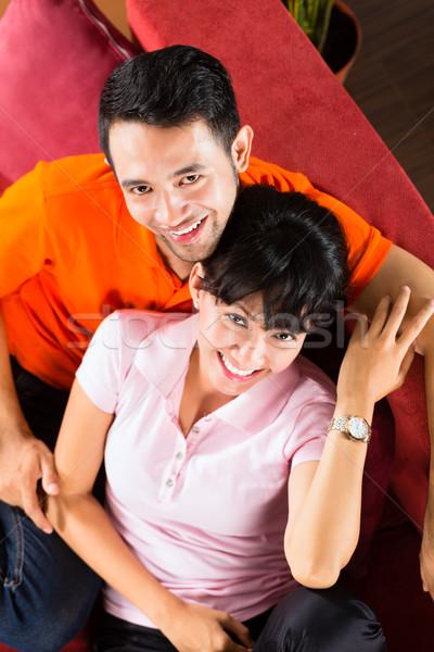 Asian couple at home on sofa Stock photo © Kzenon