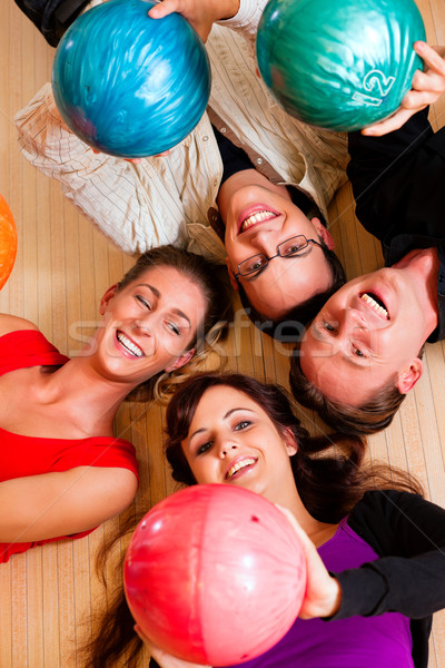 Friends bowling together Stock photo © Kzenon