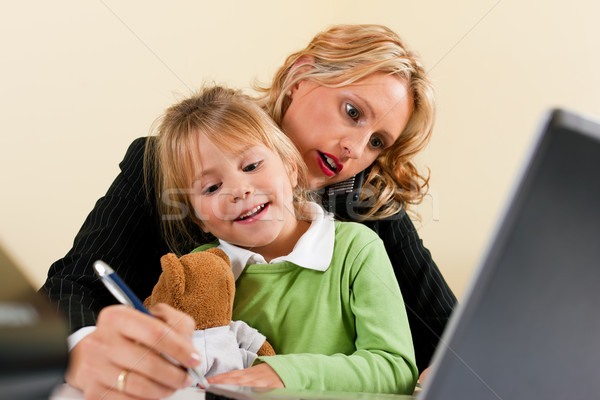 Businesswoman and mother is working at home Stock photo © Kzenon