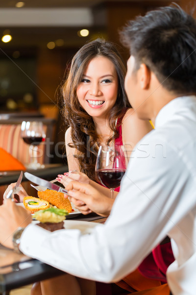 Chinese couple having romantic dinner in fancy restaurant Stock photo © Kzenon