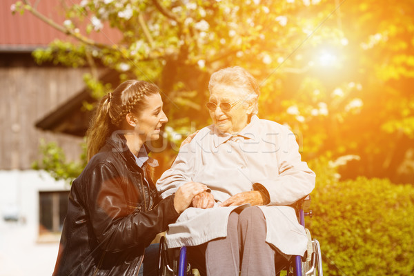 woman visiting grandmother in nursing home Stock photo © Kzenon