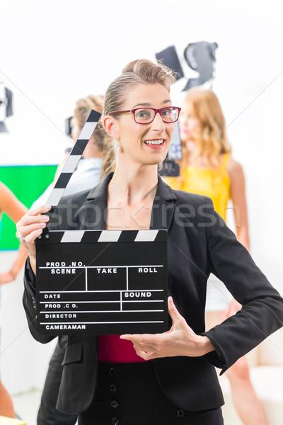 Woman with take clap at video production on film set Stock photo © Kzenon