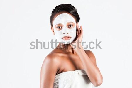 Beautiful African woman in Studio with facial mask Stock photo © Kzenon