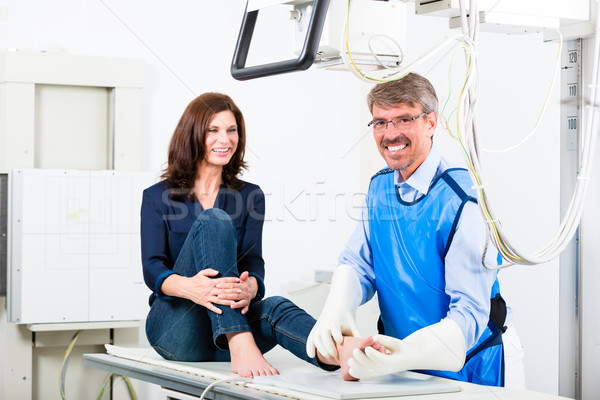 Doctor making x-ray of patient leg in surgery Stock photo © Kzenon