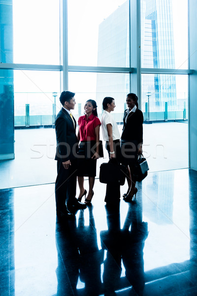 Group of business people standing in lobby or hall Stock photo © Kzenon