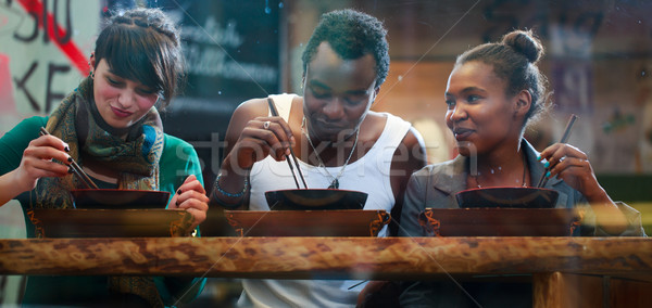 Man and women eating late in Korean eatery Stock photo © Kzenon