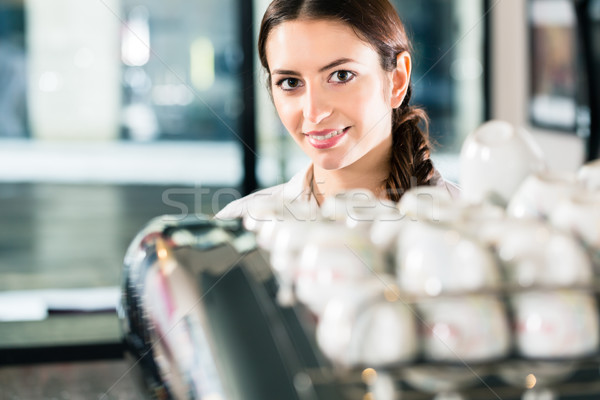 Young woman working in a commercial kitchen Stock photo © Kzenon