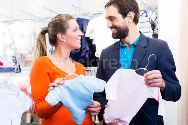 Woman and man expecting twins buying baby clothes Stock photo © Kzenon