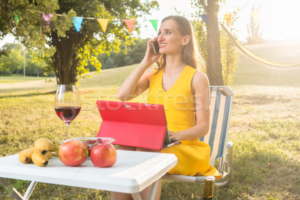 Successful female entrepreneur managing business sitting in the park Stock photo © Kzenon