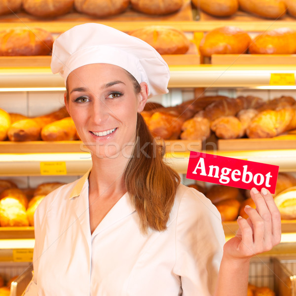 Female baker selling bread in bakery Stock photo © Kzenon