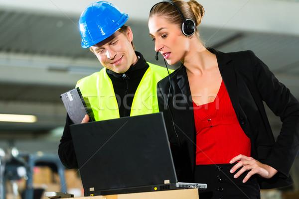 Coworkers at warehouse of forwarding company Stock photo © Kzenon