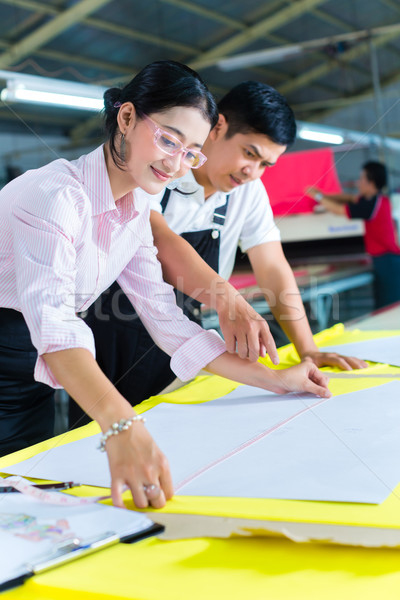 Asian production manager and designer in factory Stock photo © Kzenon