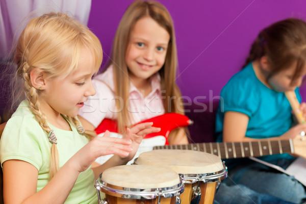 Stock photo: Children making music