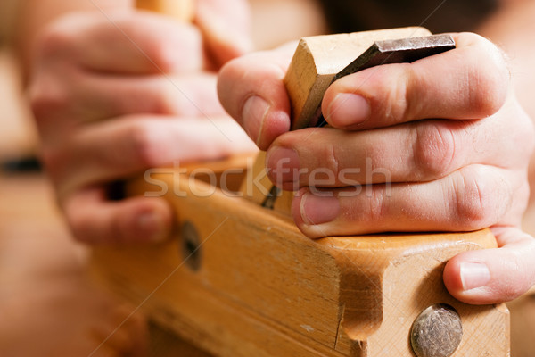 Carpenter with wood planer Stock photo © Kzenon