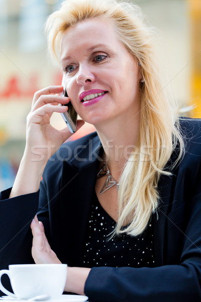 Woman with phone in cafe drinking coffee Stock photo © Kzenon
