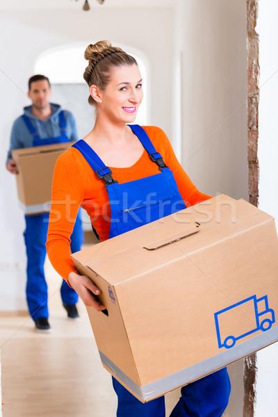 Nő férfi mozog új otthon dobozok ház Stock fotó © Kzenon