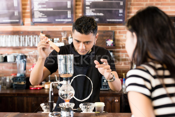 Woman watching barista preparing drip coffee in cafe Stock photo © Kzenon