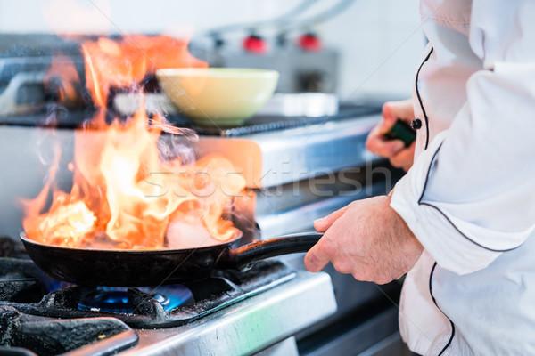повар блюдо большой огня пламени Сток-фото © Kzenon