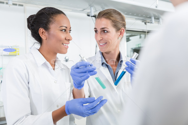 Researchers doing experiment in science lab  Stock photo © Kzenon