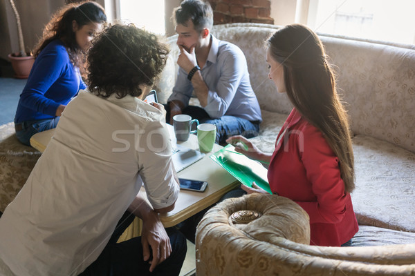 founders of start-up business meeting on grandmas old sofa Stock photo © Kzenon