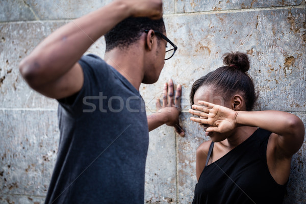 Violent young man threatening his girlfriend with his fist outdo Stock photo © Kzenon