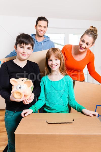 Family moving into new home Stock photo © Kzenon