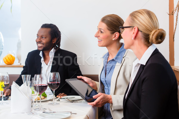 Team of business people having lunch Stock photo © Kzenon
