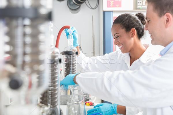 Corpo científico laboratório sorridente homem trabalhar Foto stock © Kzenon