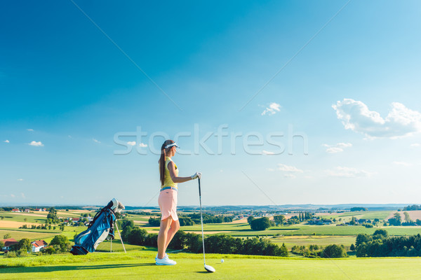 Fit woman looking at the horizon on the green grass of a golf course Stock photo © Kzenon