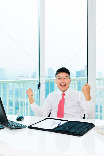Asian broker trading in office making profit Stock photo © Kzenon