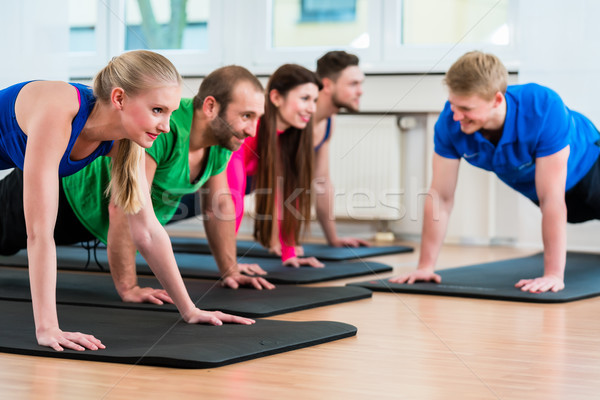 Workout group in gymnasium during physiotherapy  Stock photo © Kzenon