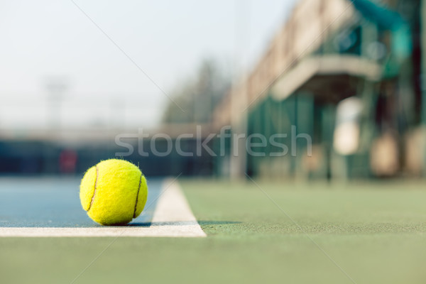 High-angle close-up of a fluorescent yellow tennis ball in the court Stock photo © Kzenon