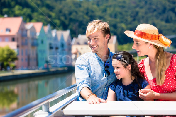Family on river cruise in summer sitting in ship Stock photo © Kzenon