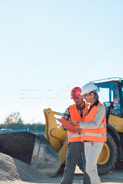 Stock photo: Man and woman worker on construction site