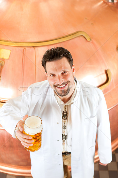 brewer with beer glass in brewery Stock photo © Kzenon