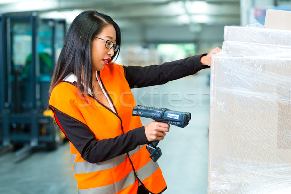 worker scans package in warehouse of forwarding Stock photo © Kzenon