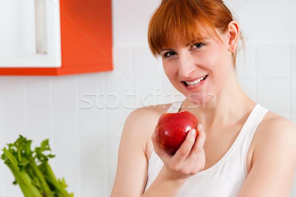 Healthy eating - woman with apple Stock photo © Kzenon