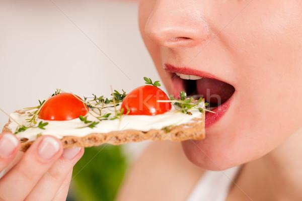 Healthy eating - woman with crispbread Stock photo © Kzenon