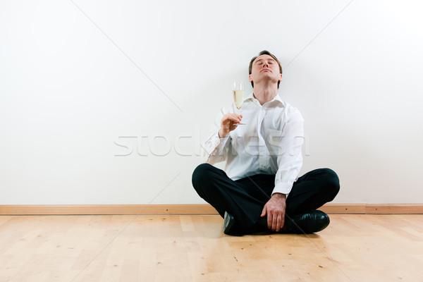 Man in apartment with champagne Stock photo © Kzenon
