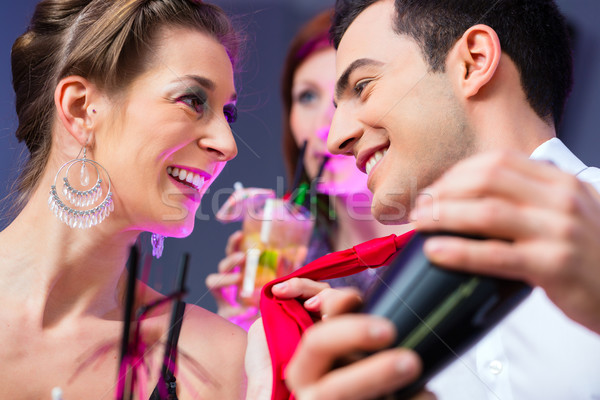 Woman flirting with barkeeper Stock photo © Kzenon