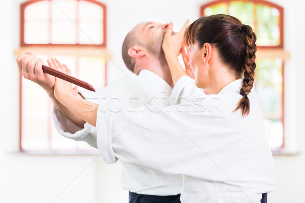 Man and woman having Aikido knife fight Stock photo © Kzenon